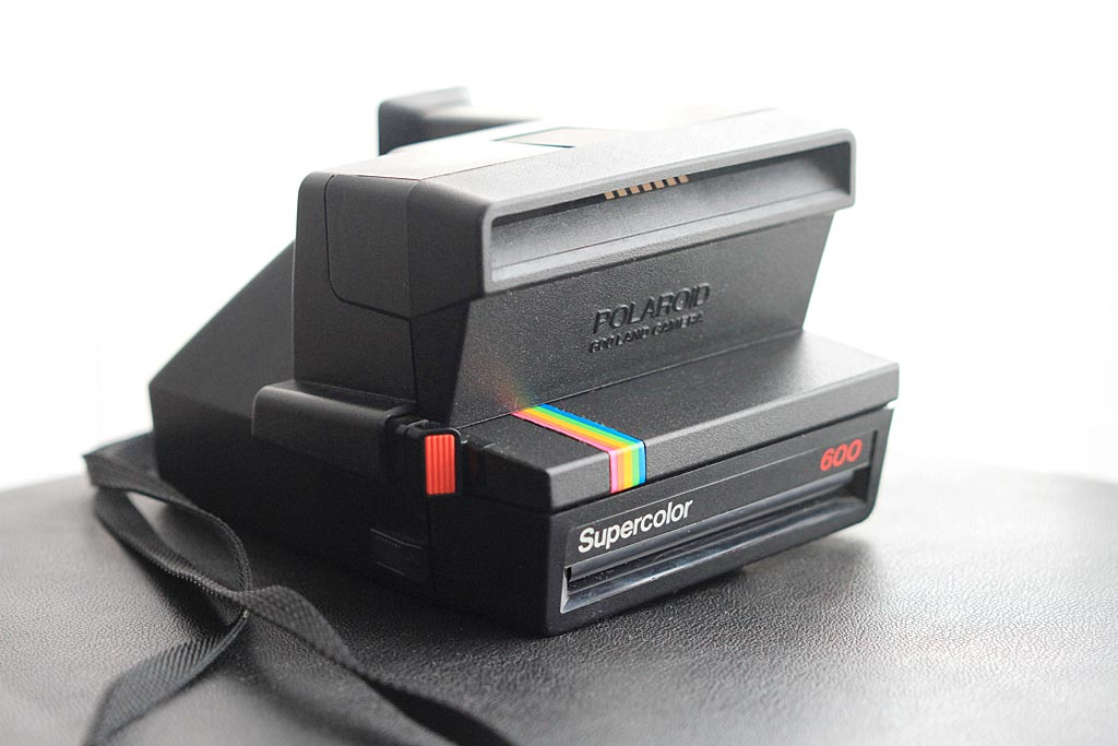 When closed, the Polaroid 600 is a little more compact than models which have an integrated flash. The Polaroid 600 can receive an external flash that attaches in the slot shown in this photo.