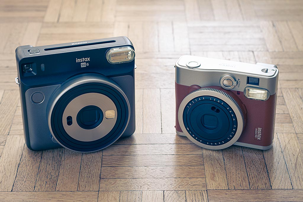 The Instax Square SQ6 and the Instax Mini 90 Neo Classic offer approximately the same features. The images produced by the SQ6 are larger, but the camera's size is also bigger.